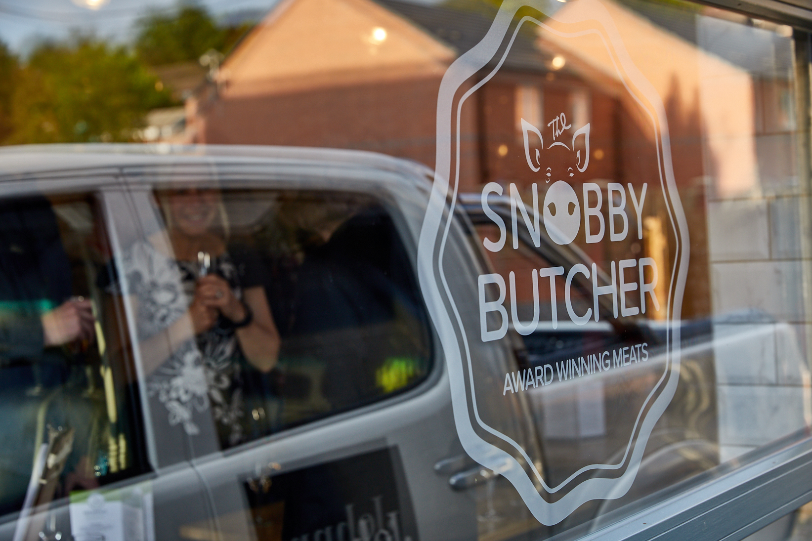Snobby Butcher Logo on Window